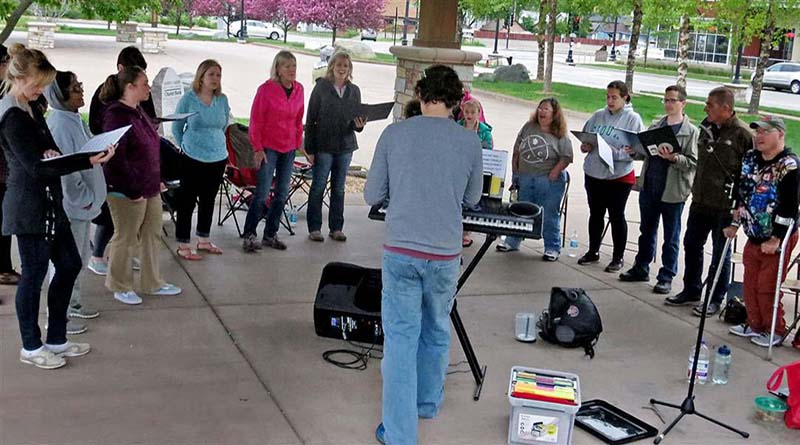 The CollECtive Choir rehearsing at Phoenix Park in Eau Claire Wi.