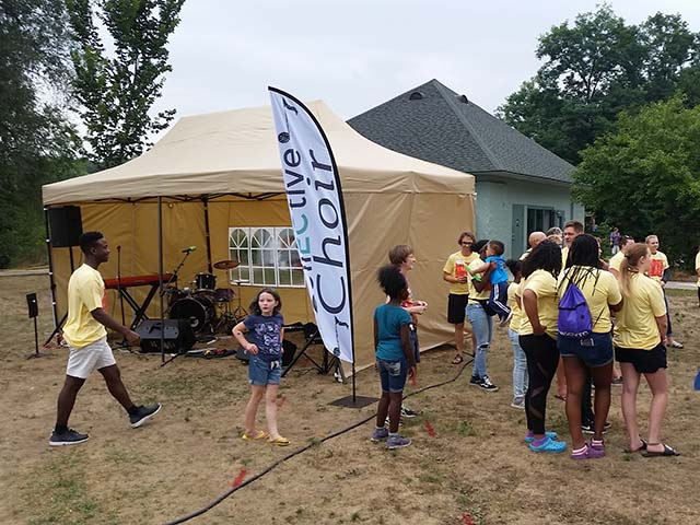The CollECtive Choir performs at a block party and backpack giveaway in conjuntion with Ekklesia Church and the Kings Closet at Boyd Park in Eau Claire Wi
