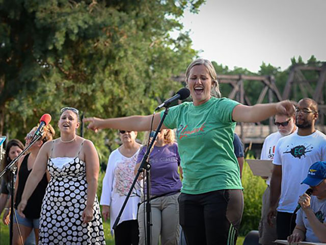Our Hip Hop CollECtive Choir pesenting testimonies at Phoenix Park in Eau Claire. Mission