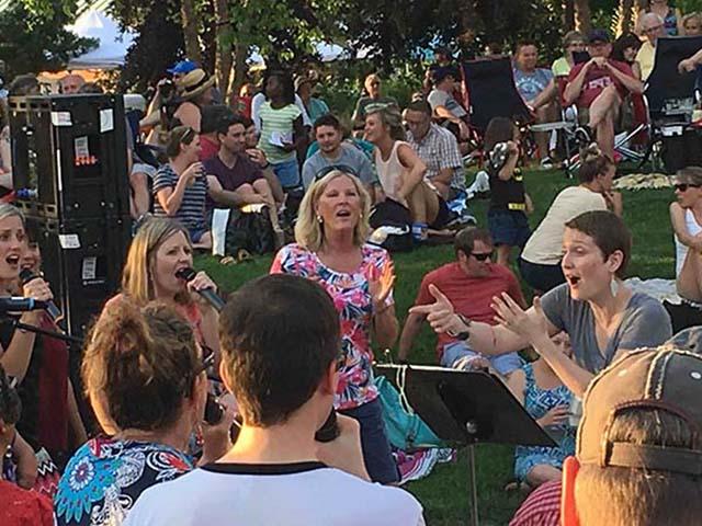 The CollECtive Choir performs at the 'Sounds Like Summer' concert, produced by Volume One Magazine, located at Phoenix Park in Eau Claire  Wi