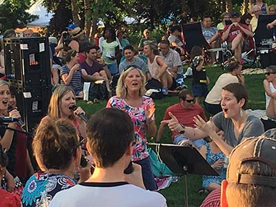 The Collective Choir performed at the 'Sounds Like Summer' Volume One concert at Phoenix Park in Eau Claire Wi 2018.